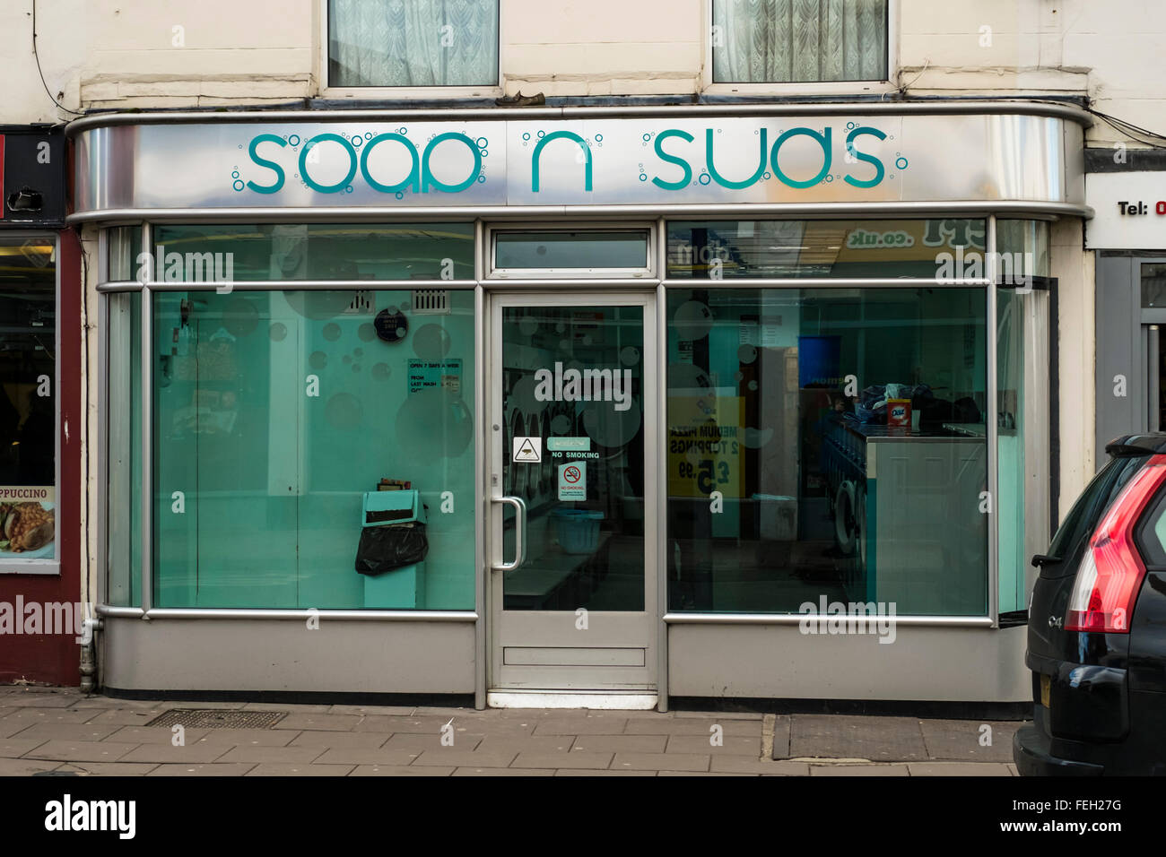 Cheltenham a spa town on the edge of the Cotswolds Gloucesterhire Soap and suds Laundrete - Stock Image
