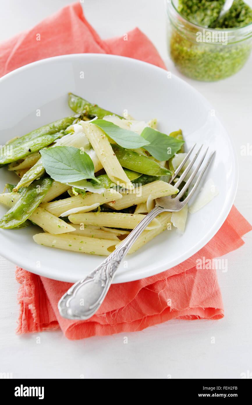 spring pasta with green peas, food closeup - Stock Image