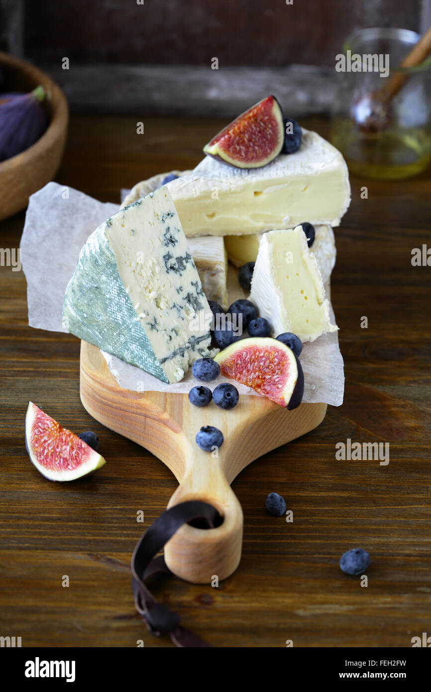 cheese mix on cutting boards, food - Stock Image