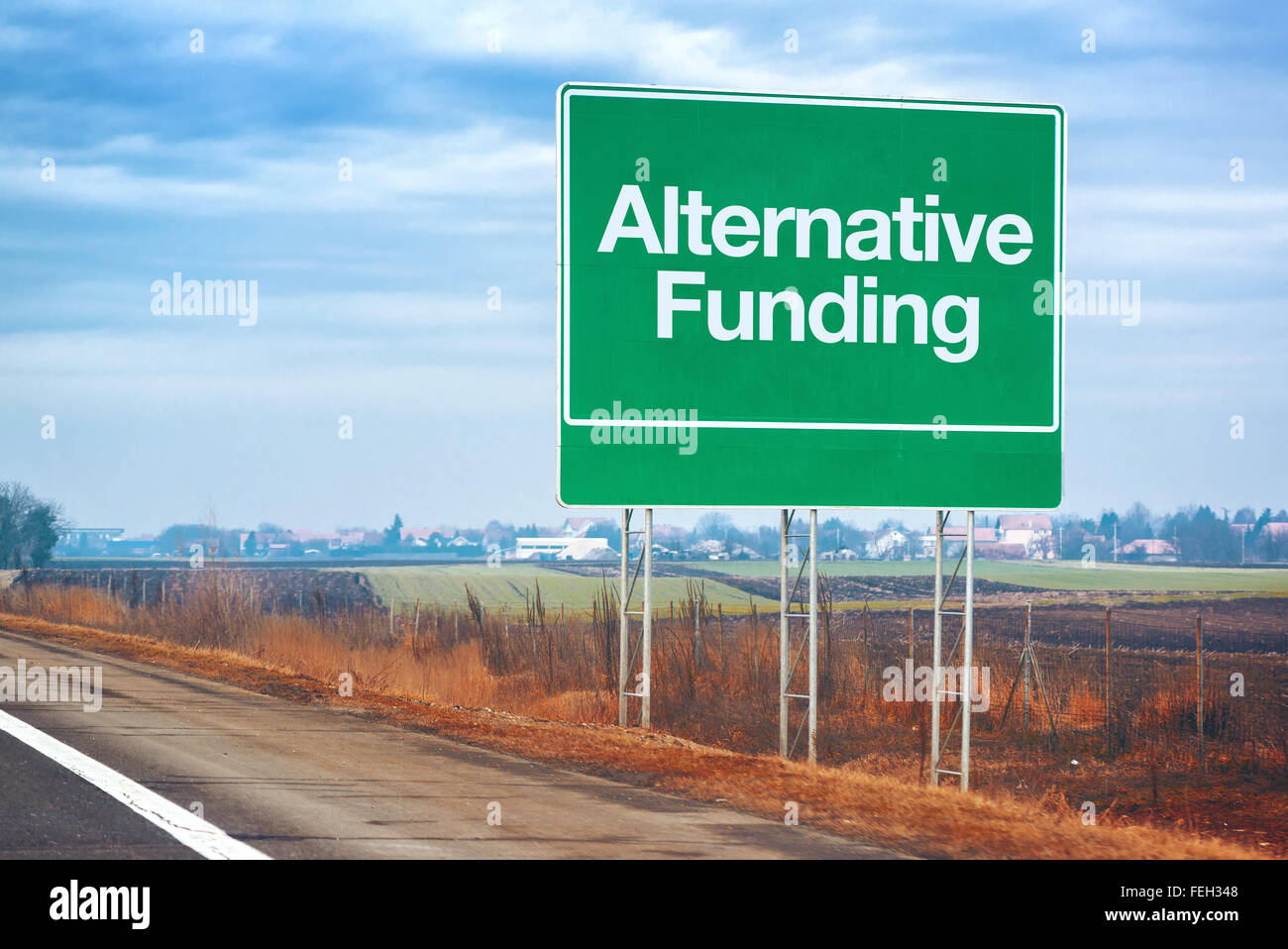 Alternative funding on road sign, entrepreneurship and business concept with road sign by the highway - Stock Image
