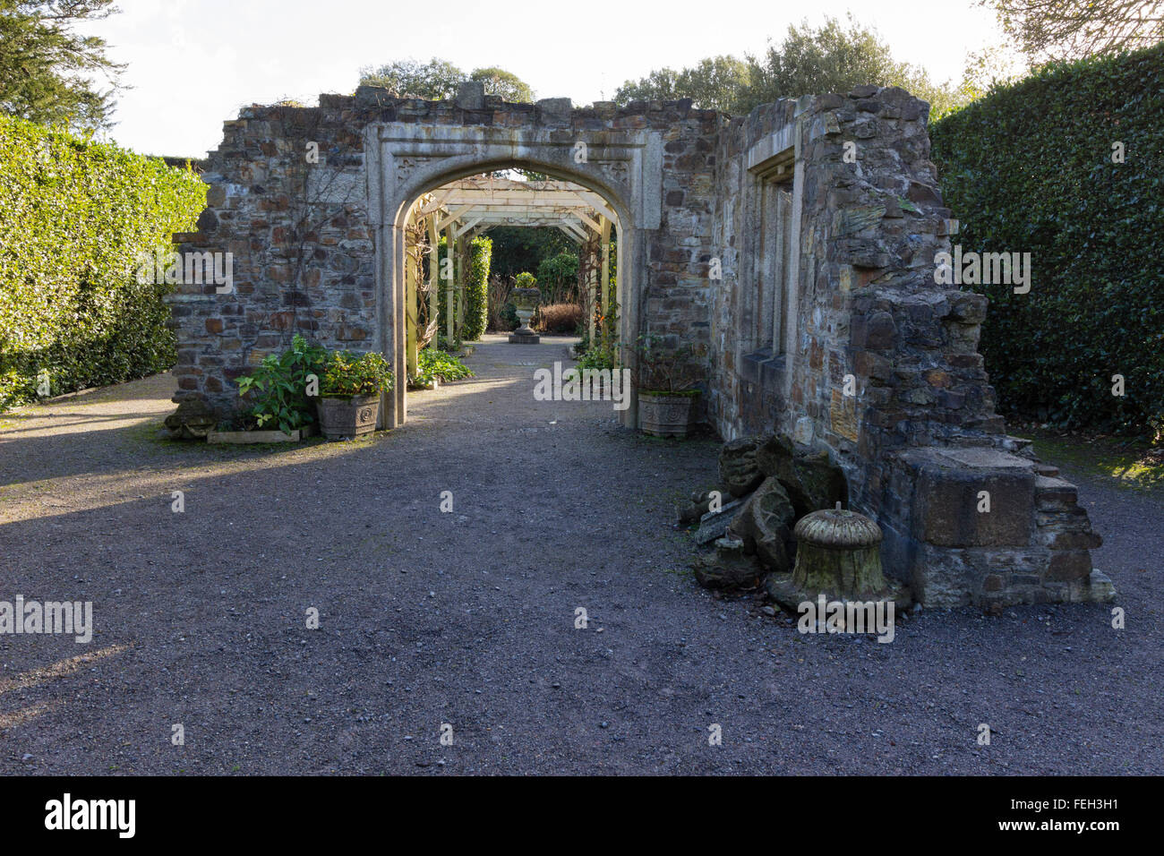 Late winter sunlight lights the reconstructed stonework of the relic garden at Mt Edgcumbe, Cornwall - Stock Image