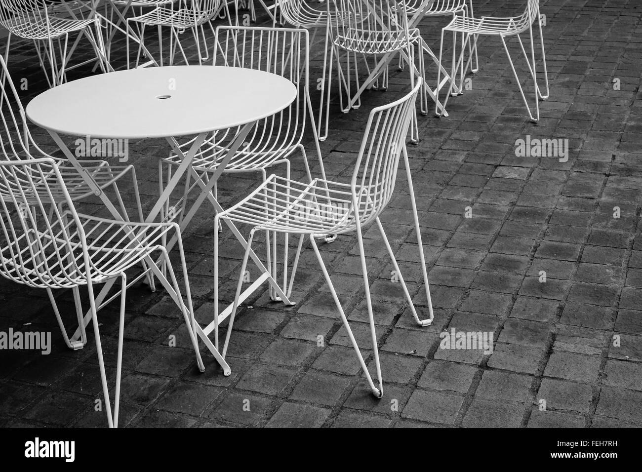 chairs sidewalk pavement Stock Photo