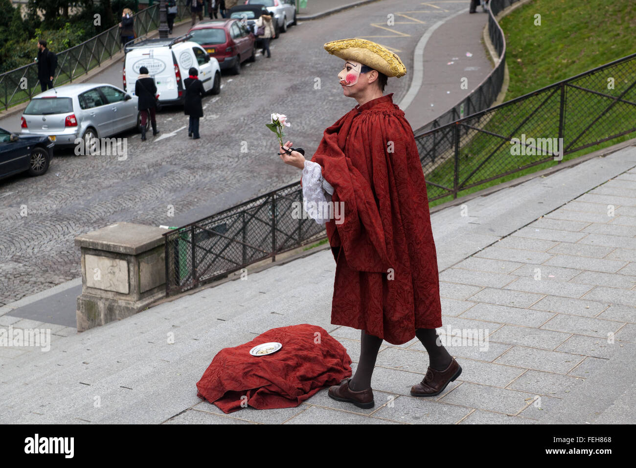 Mime artist performing on steps in front of the Sacre Coeur cathedral in Paris, France. - Stock Image