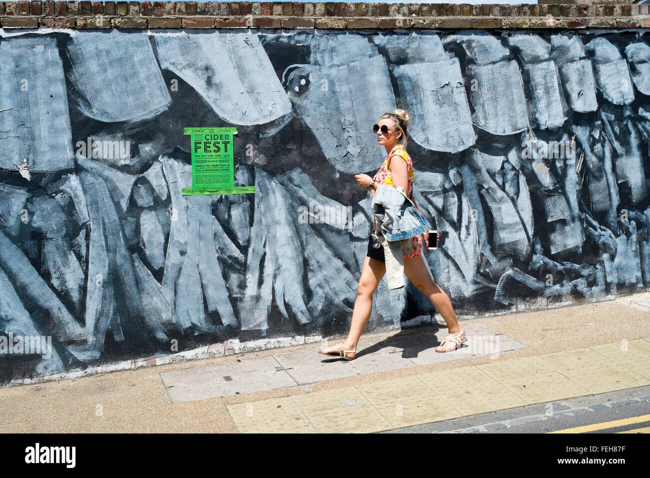 art arty wall graffiti urban Hackney London sidewalk - Stock Image