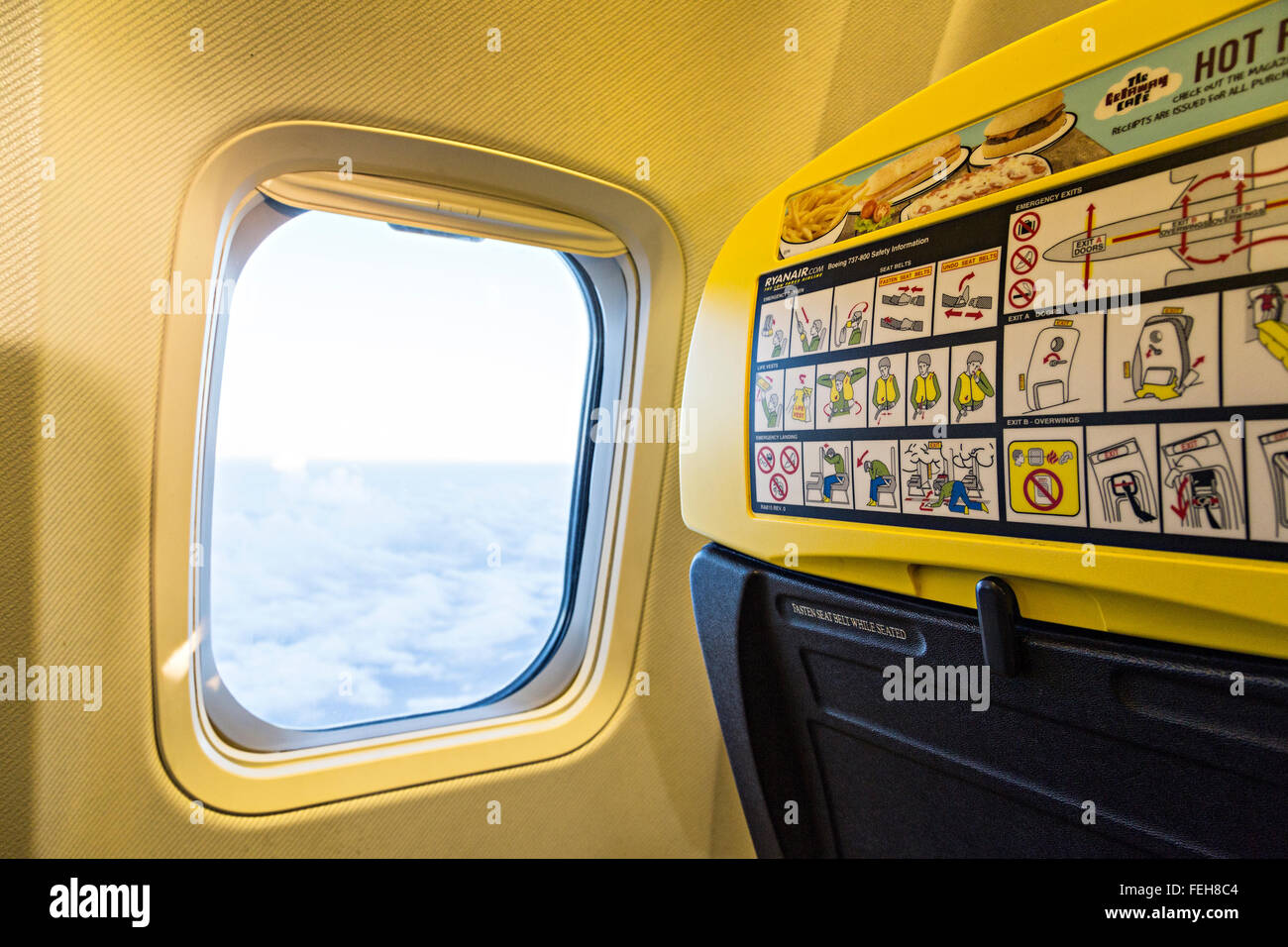 Safety instruction on chair back in Ryanair cabin during flight, UK - Stock Image