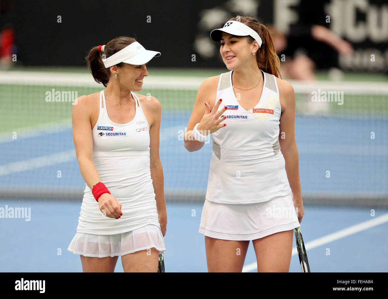 Leipzig, Germany. 07th Feb, 2016. Martina Hingis (L) and Belinda Bencic of Switzerland talk during their match against - Stock Image