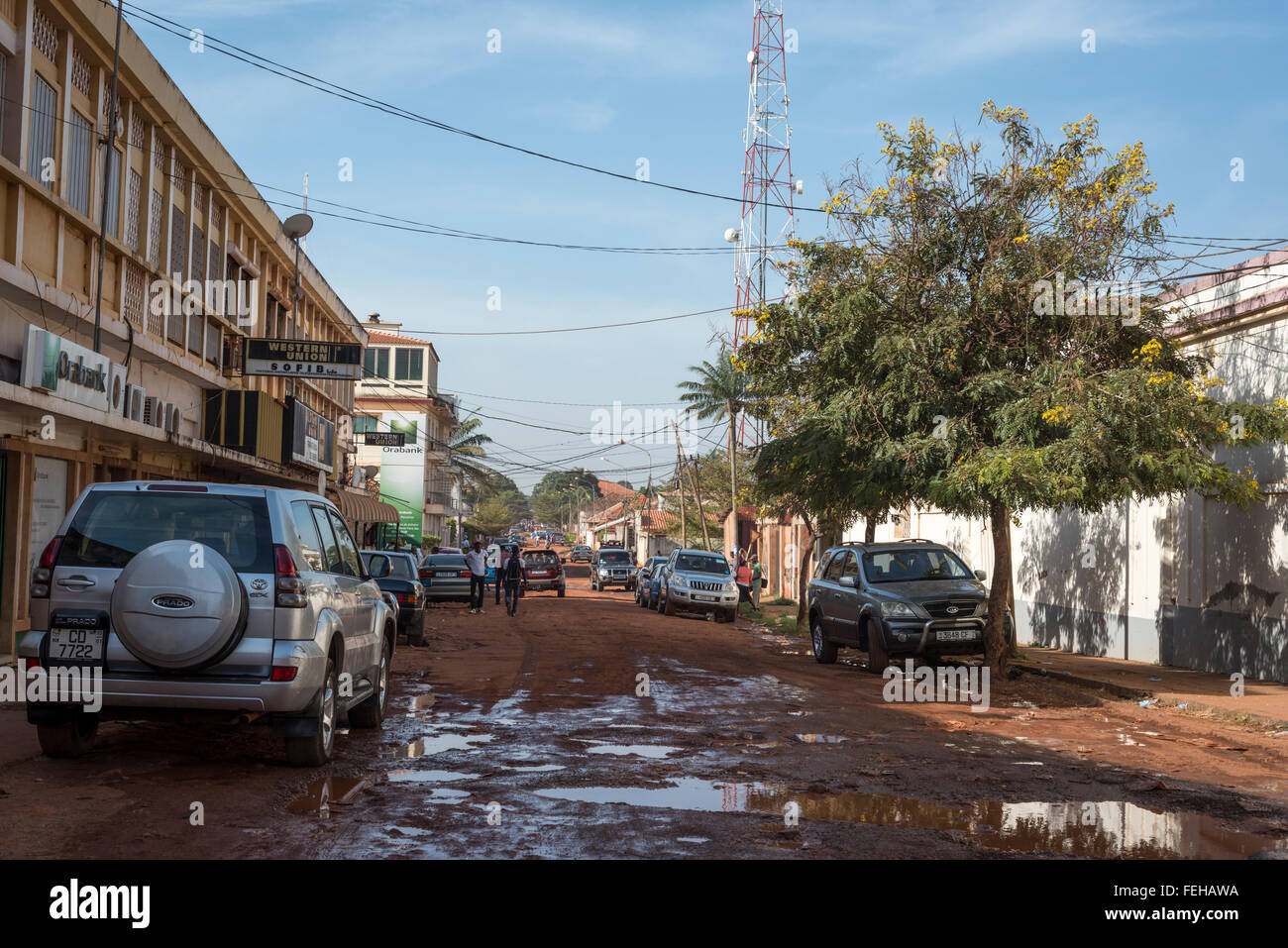 An unpaved road in the Guinea Bissau capital city of Bissau - Stock Image