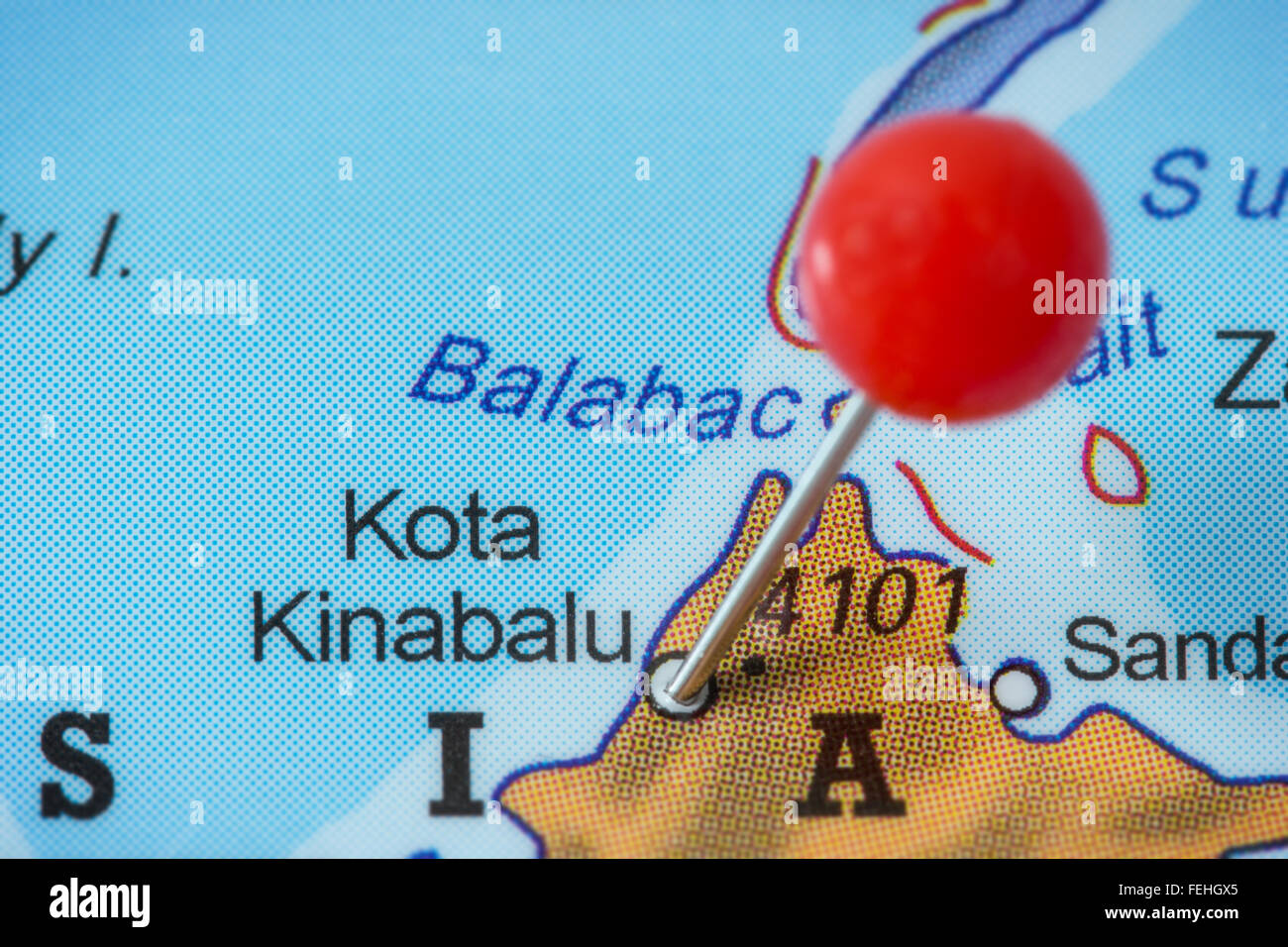 Close-up of a red pushpin in a map of Kota Kinabalu, Malaysia. - Stock Image