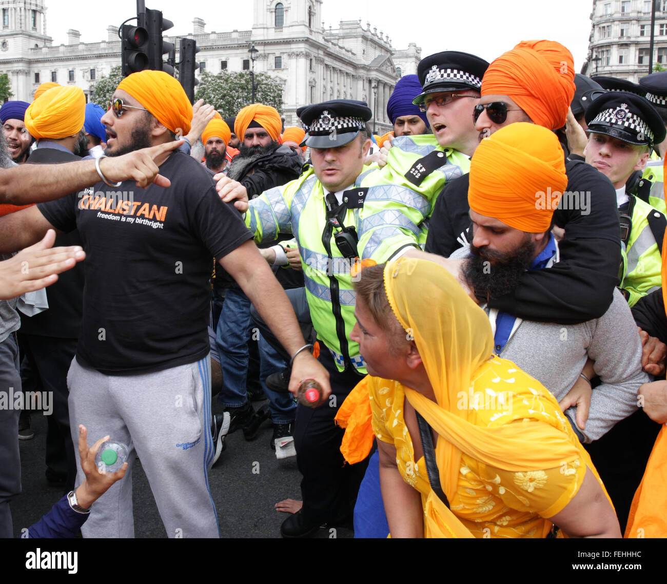 London, UK, 15th July 2015: Sikh protestors cause traffic chaos as they sit in the road outside the Houses of Parliament. Stock Photo