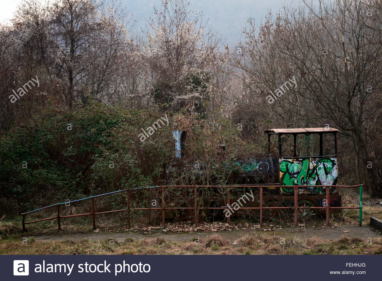 Abandoned amusement park train - Stock Image