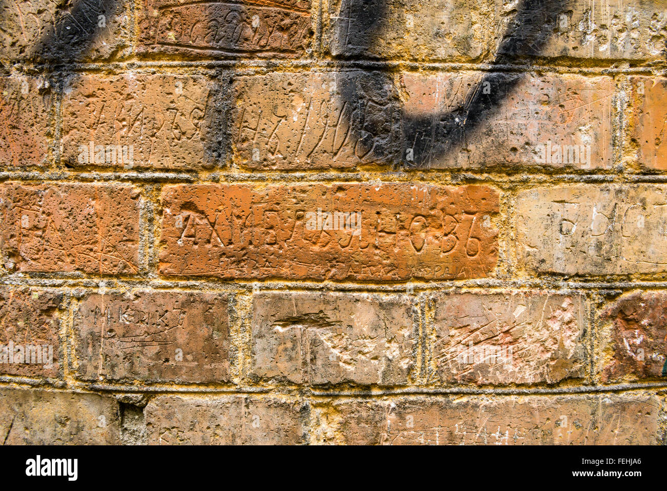 Writings with names by Russian soldiers on brick walls of Tarakaniv Fortress made in the end of XIX - beginning - Stock Image