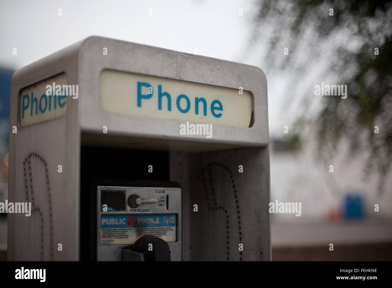 Detail of public telephone box in Beverly Hills, Los Angeles. - Stock Image