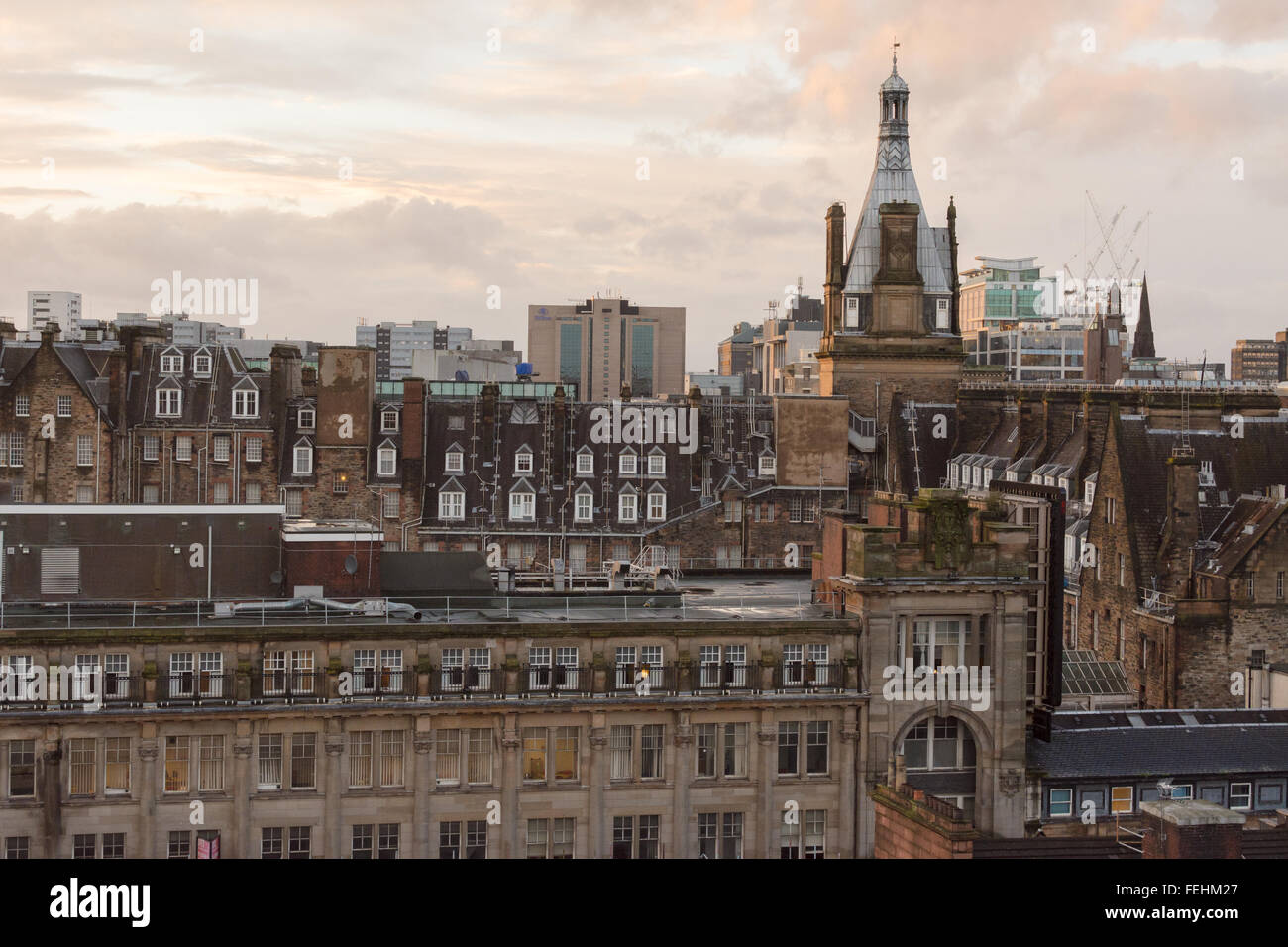 Glasgow city skyline - buildings and rooftops at sunset - Scotland, UK - Stock Image