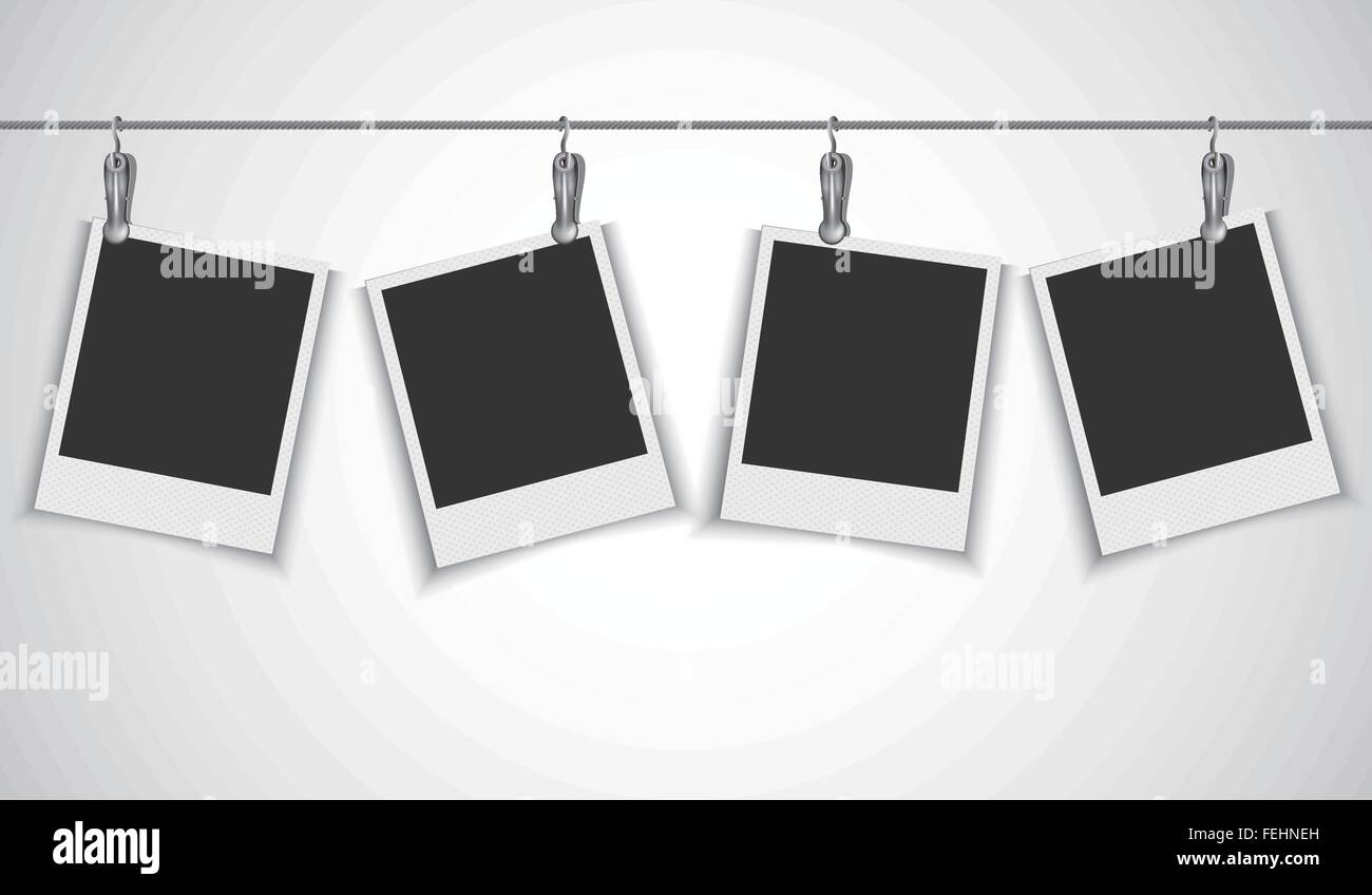 Blank photo frame hanging on a wire rope with metallic clip Stock ...