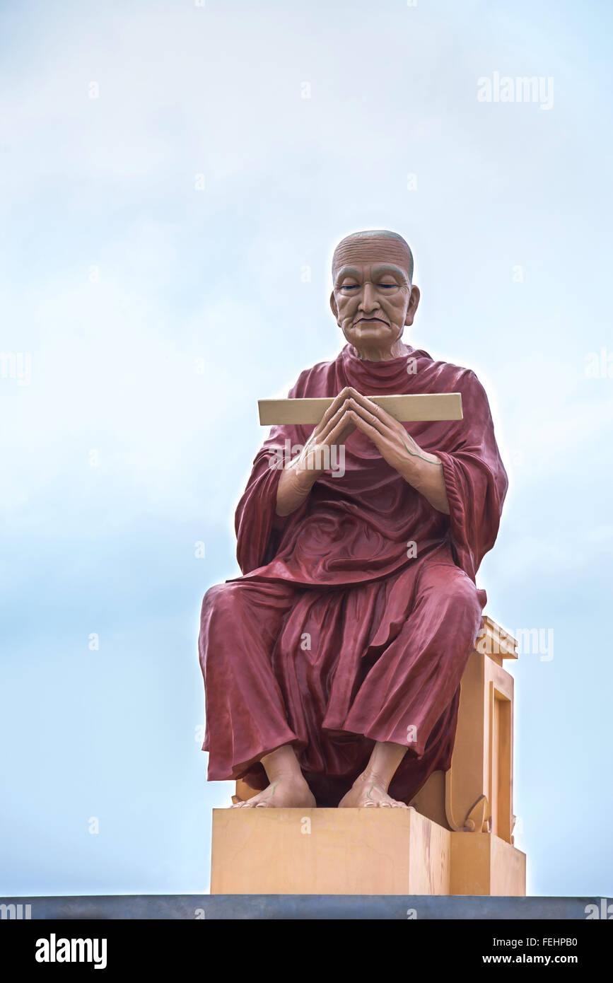 monk statue of buddhism recite scriptures - Stock Image