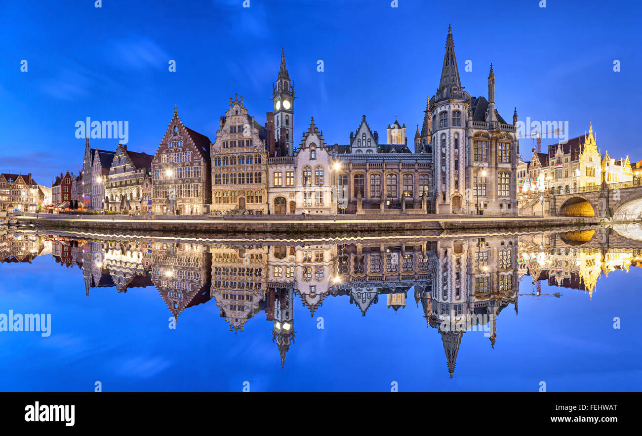 Ghent skyline reflecting in water in the evening, Flanders, Belgium - Stock Image