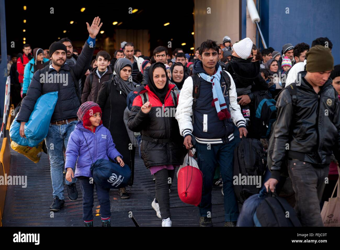 Refugees arrive from Lesbos and Chios Island at mainland Greece. Due to mild winter weather refugees continue to - Stock Image