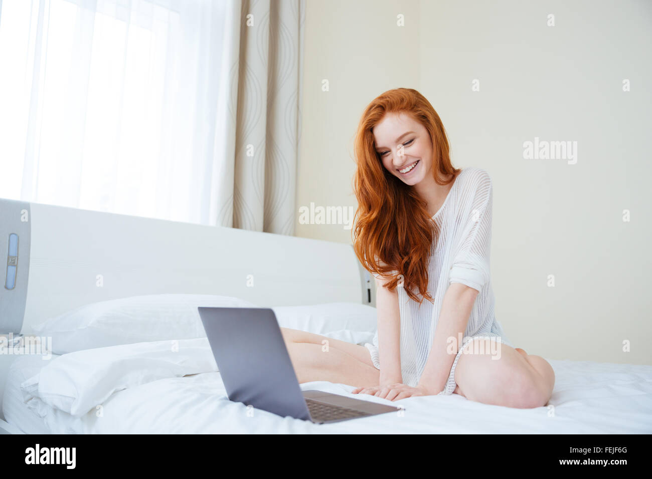 Redhead women in bed