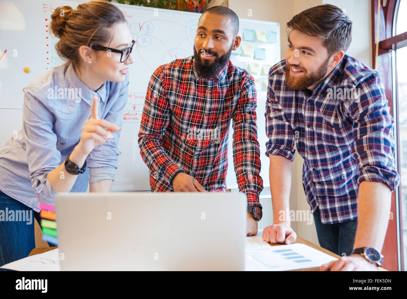 Multiethnic group of young business people working in office - Stock Image