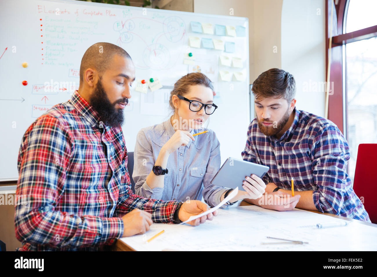 Multiethnic group of young business people working together in office - Stock Image