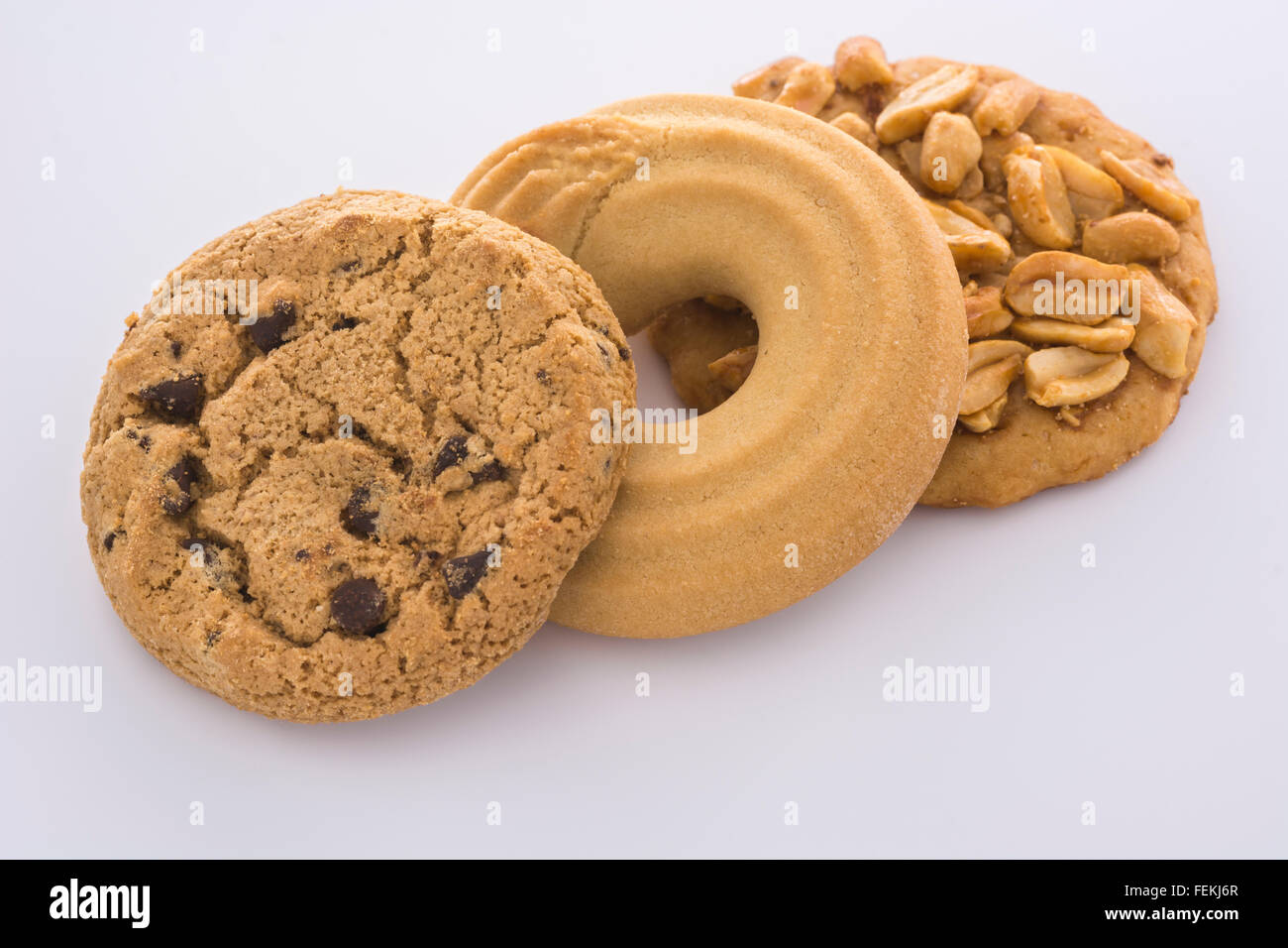 Biscuits / cookies on plain black, reflective, background - metaphor for  computer / browser / web cookies & - Stock Image