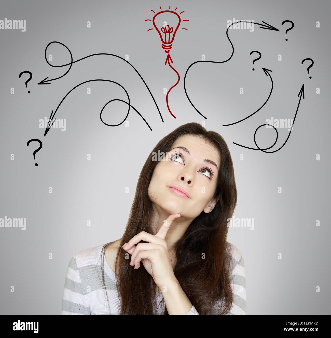 Thinking woman making decision and have an idea. She looking up on grey background - Stock Image