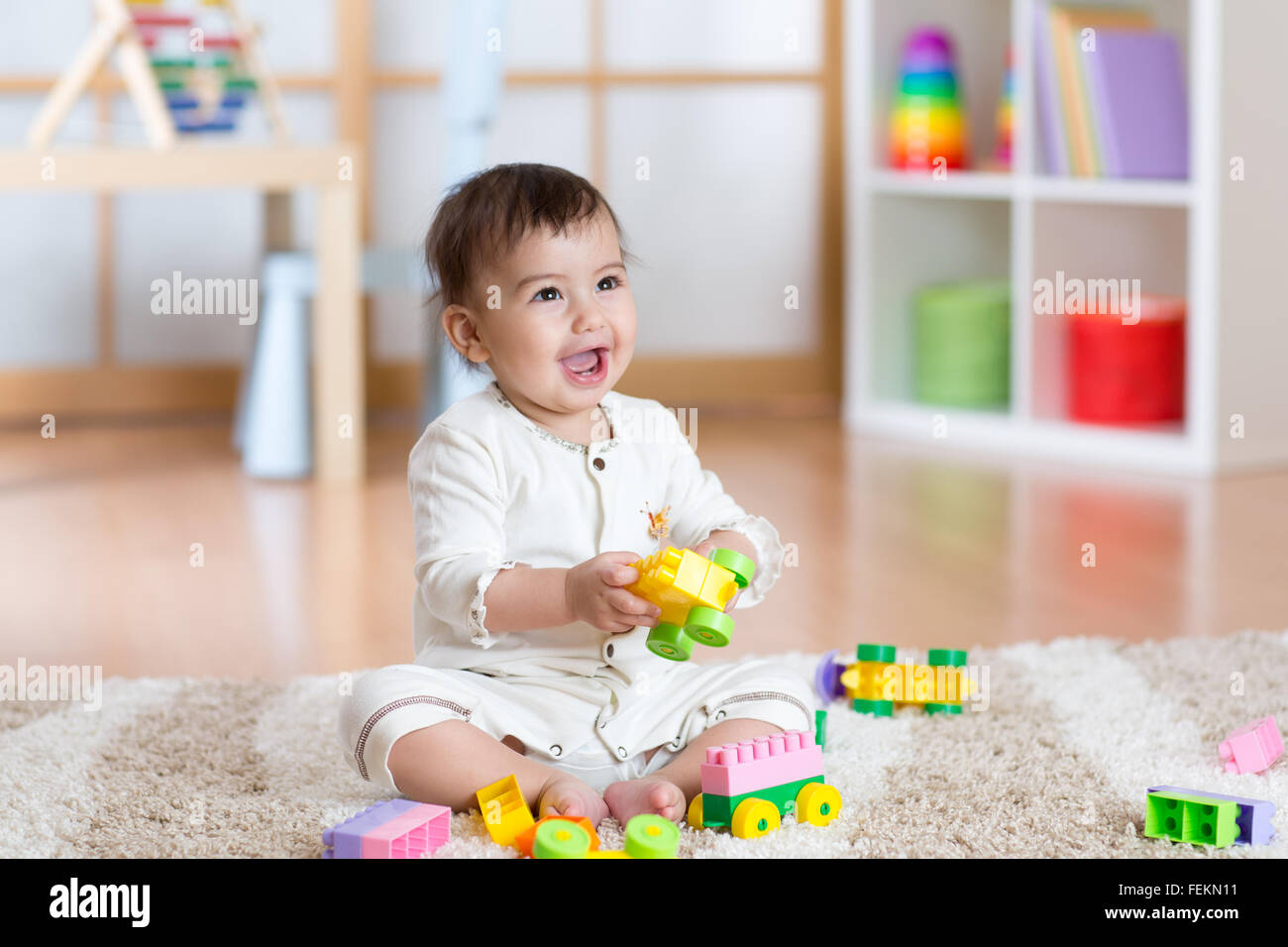 Happy baby playing in the constructor - Stock Image