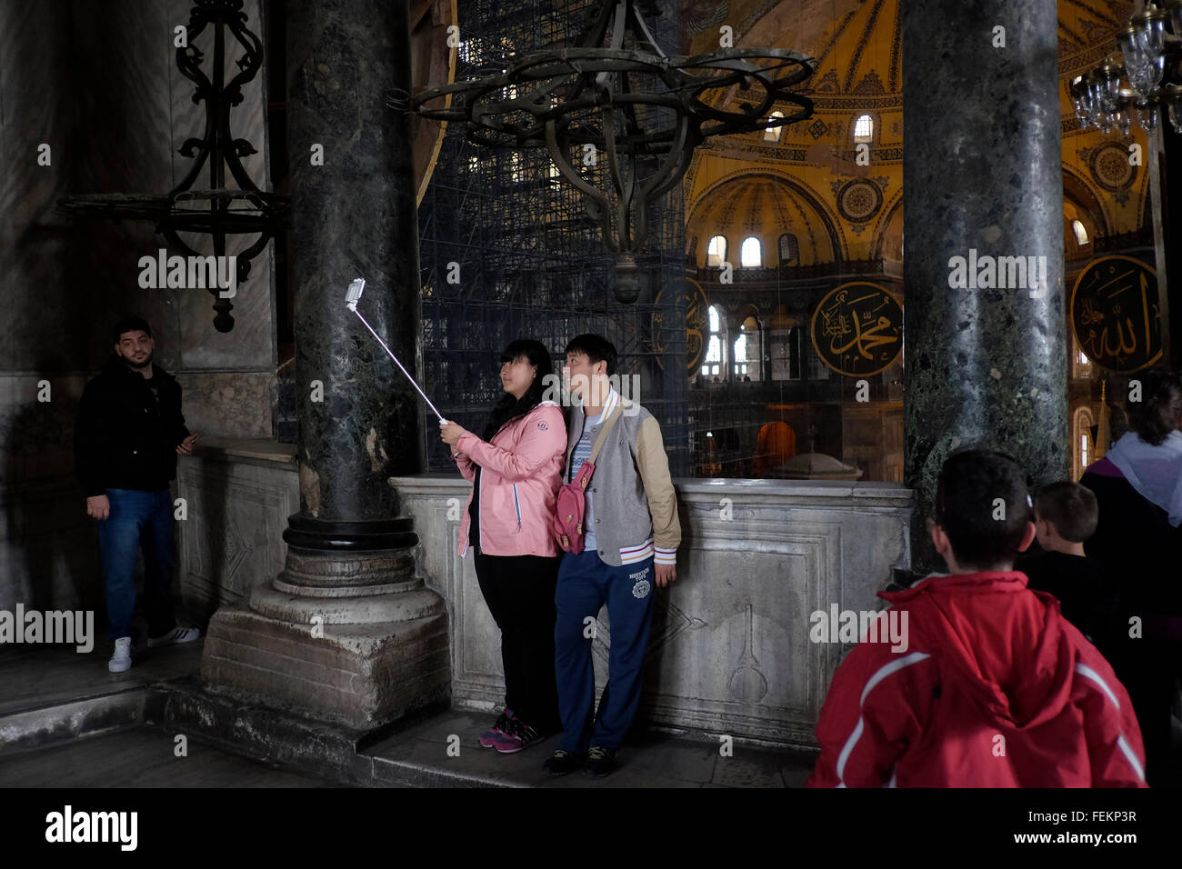 Tourists takes a selfie photo inside Hagia Sofia, in Istanbul on May 3, 2015. - Stock Image