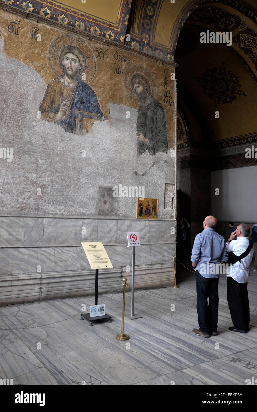 Tourists in front of The Deesis mosaic with Christ as ruler, in Hagia Sofia, Istanbul, Turkey on May 3, 2015. - Stock Image