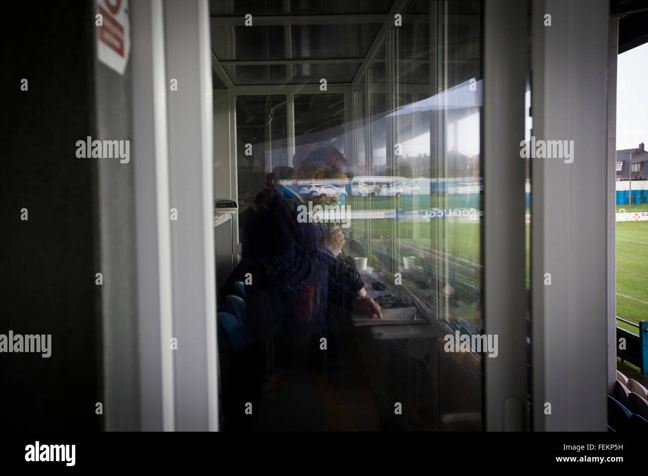 The stadium announcer working as Port Talbot Town host Caerau Ely in a Welsh Cup fourth round tie at the Genquip - Stock Image