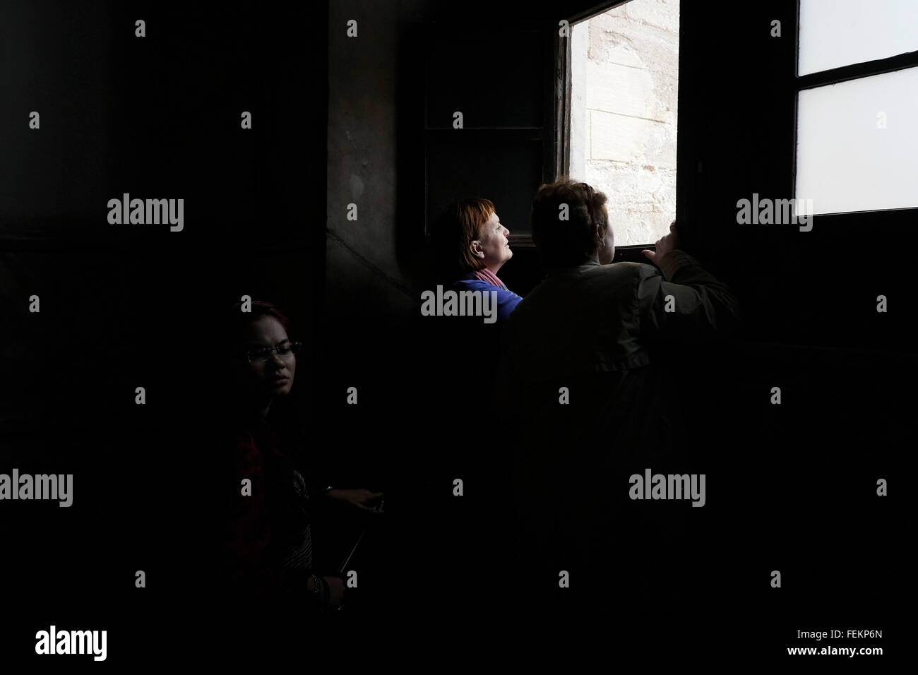 A tourist looks from a window in Hagia Sophia, Istanbul, Turkey on May 3, 2015. Stock Photo