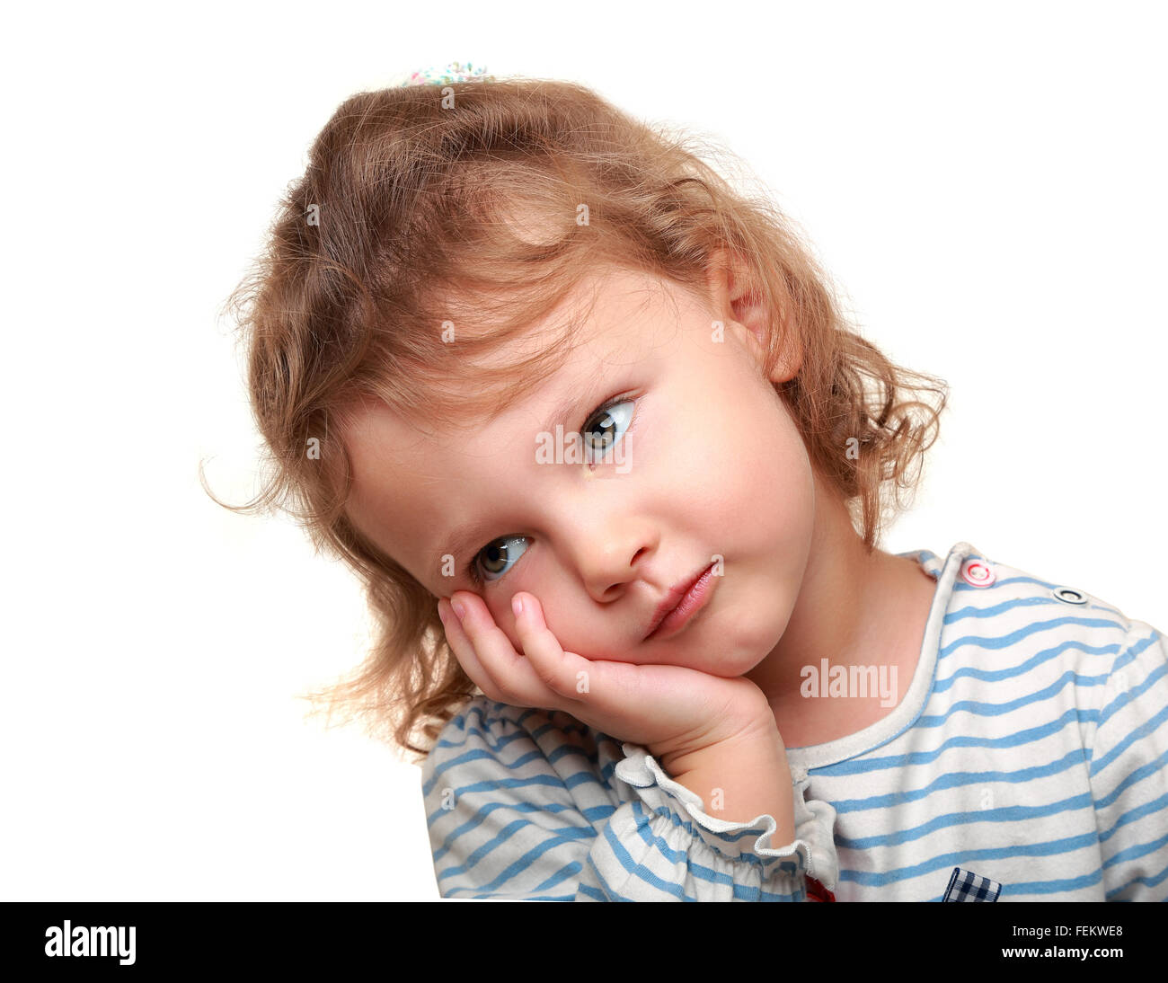 small tired cute kid girl wanting to sleep. and holding head the