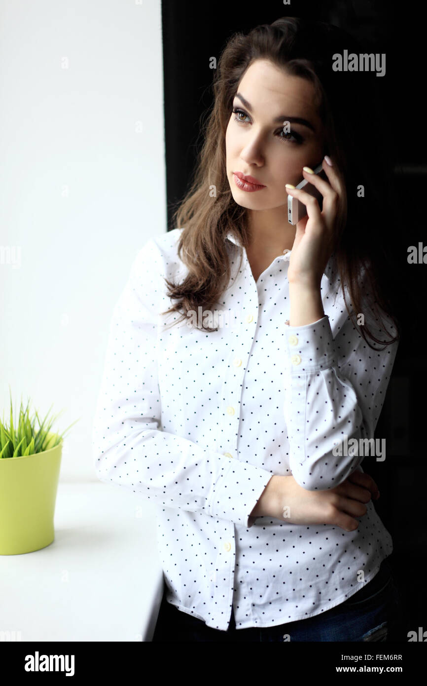 business concept - businesswoman talking on the phone in office - Stock Image