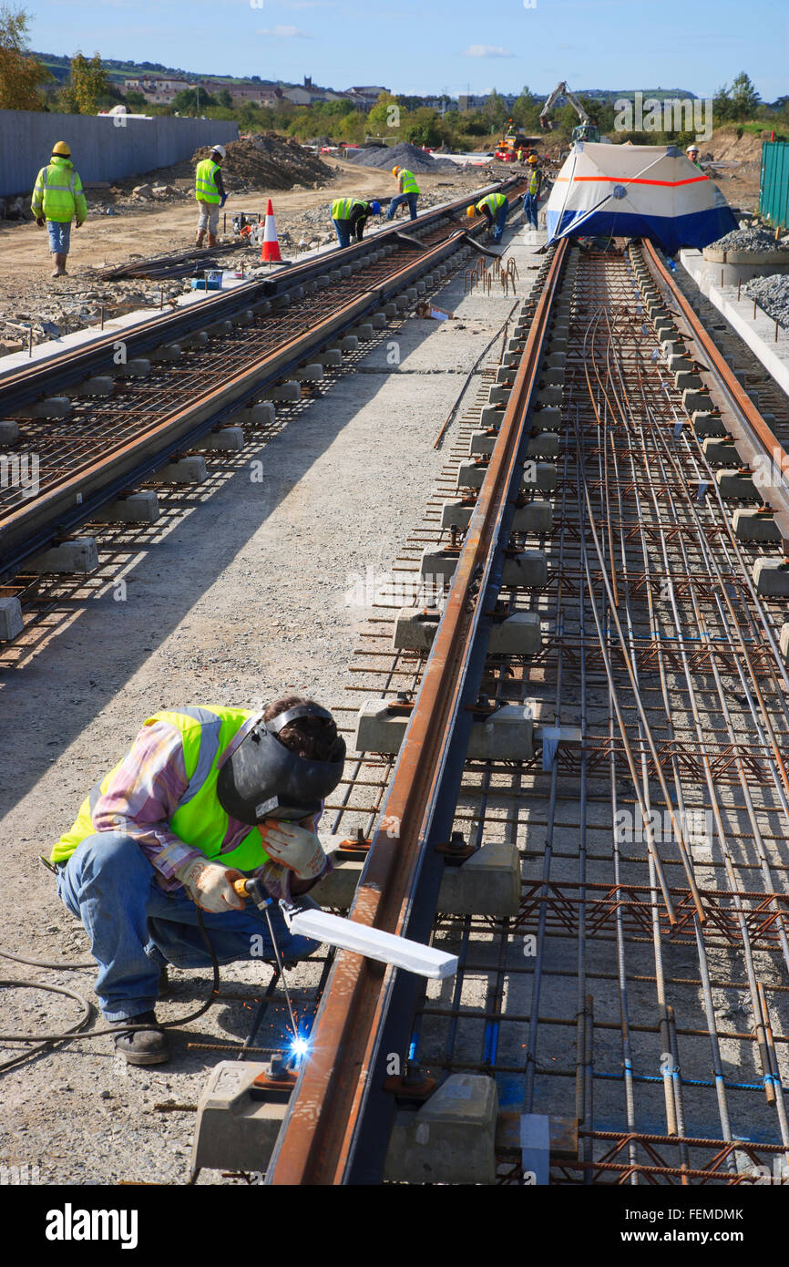 construction workers building railway tracks - Stock Image