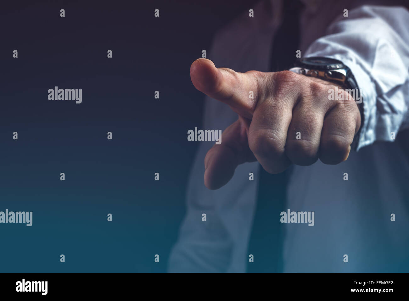 You are fired concept, boss gesturing way out hand sign with index finger Stock Photo