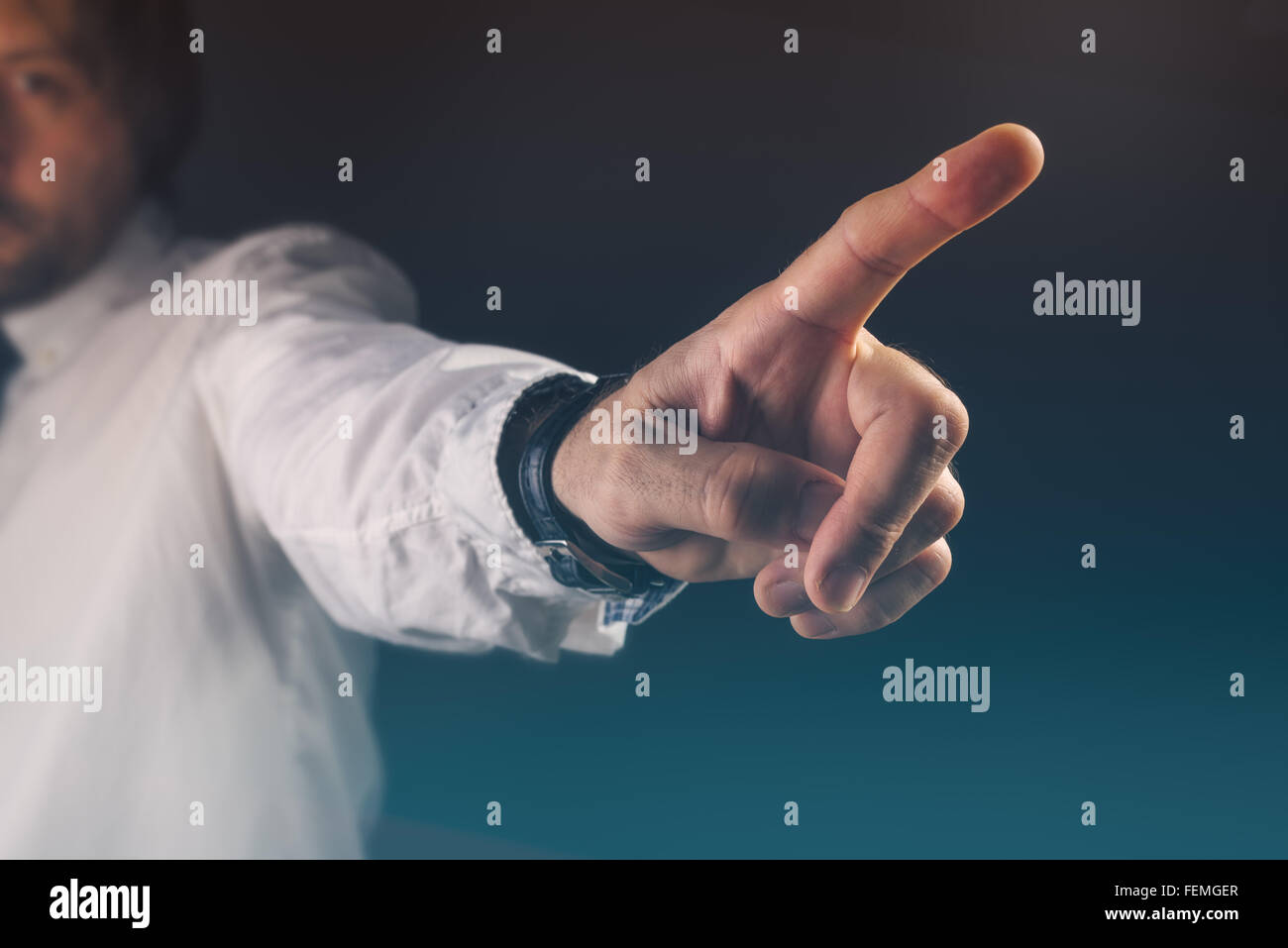 You are fired concept, boss gesturing way out hand sign with index finger - Stock Image