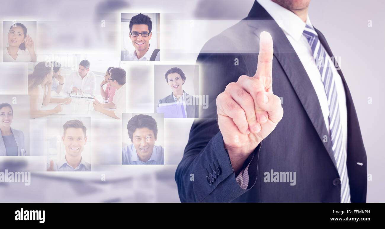 Composite image of businessman pointing with his finger - Stock Image