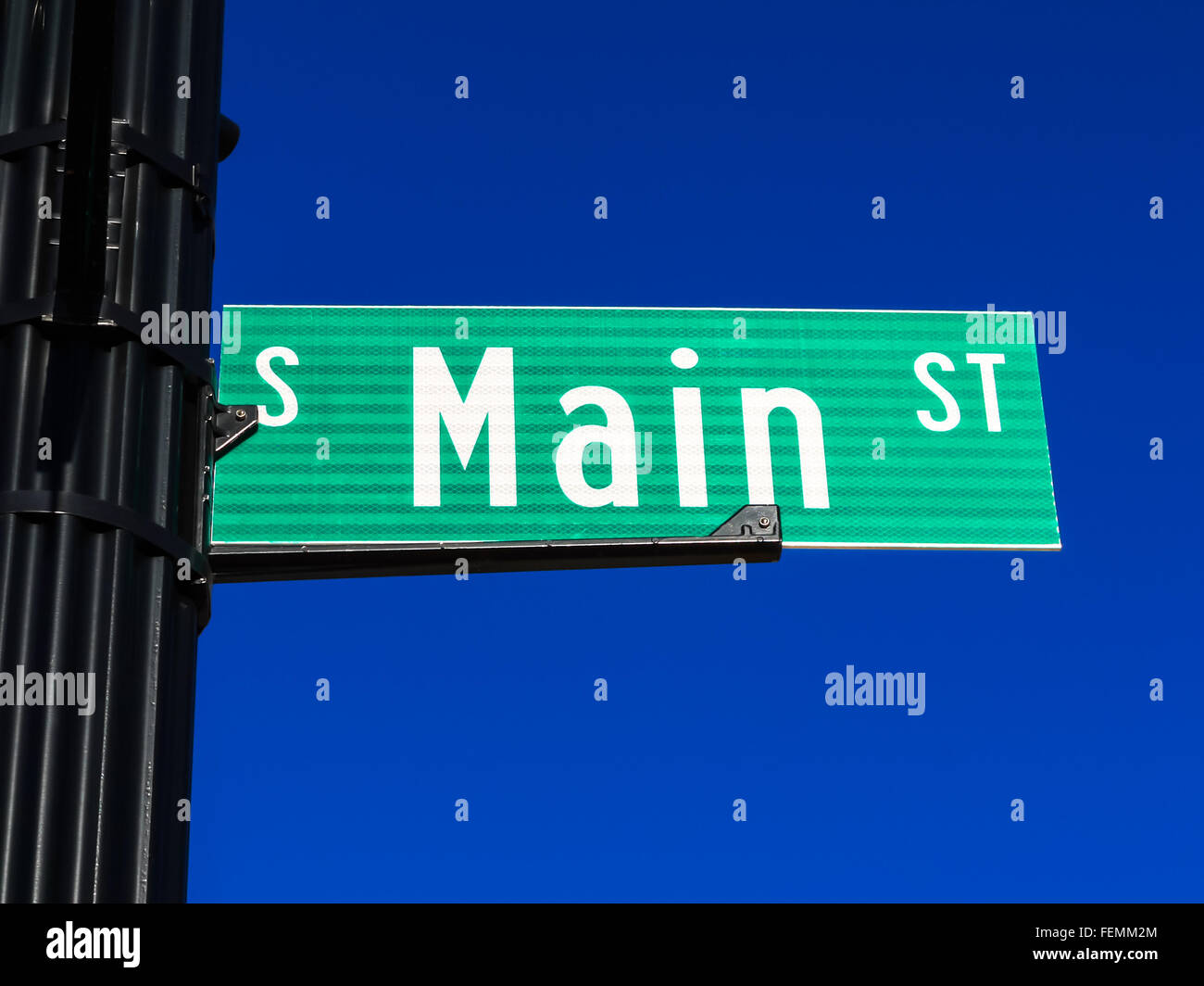 Main Street sign on a street pole. - Stock Image