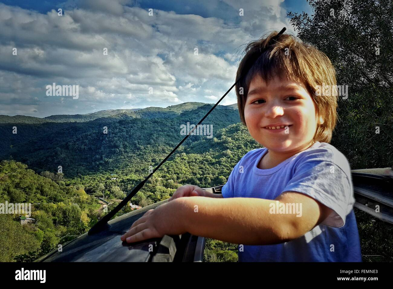 Happy Boy Standing Out Car Sun Roof - Stock Image