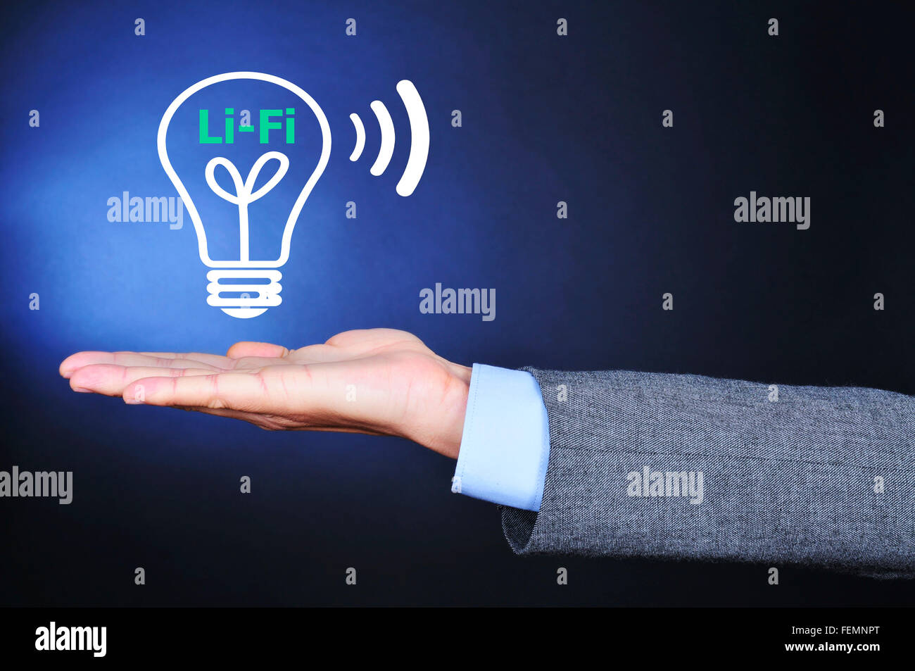 closeup of a man wearing a suit with an illustration of a lightbulb and the text Li-Fi, Light Fidelity, in the palm - Stock Image