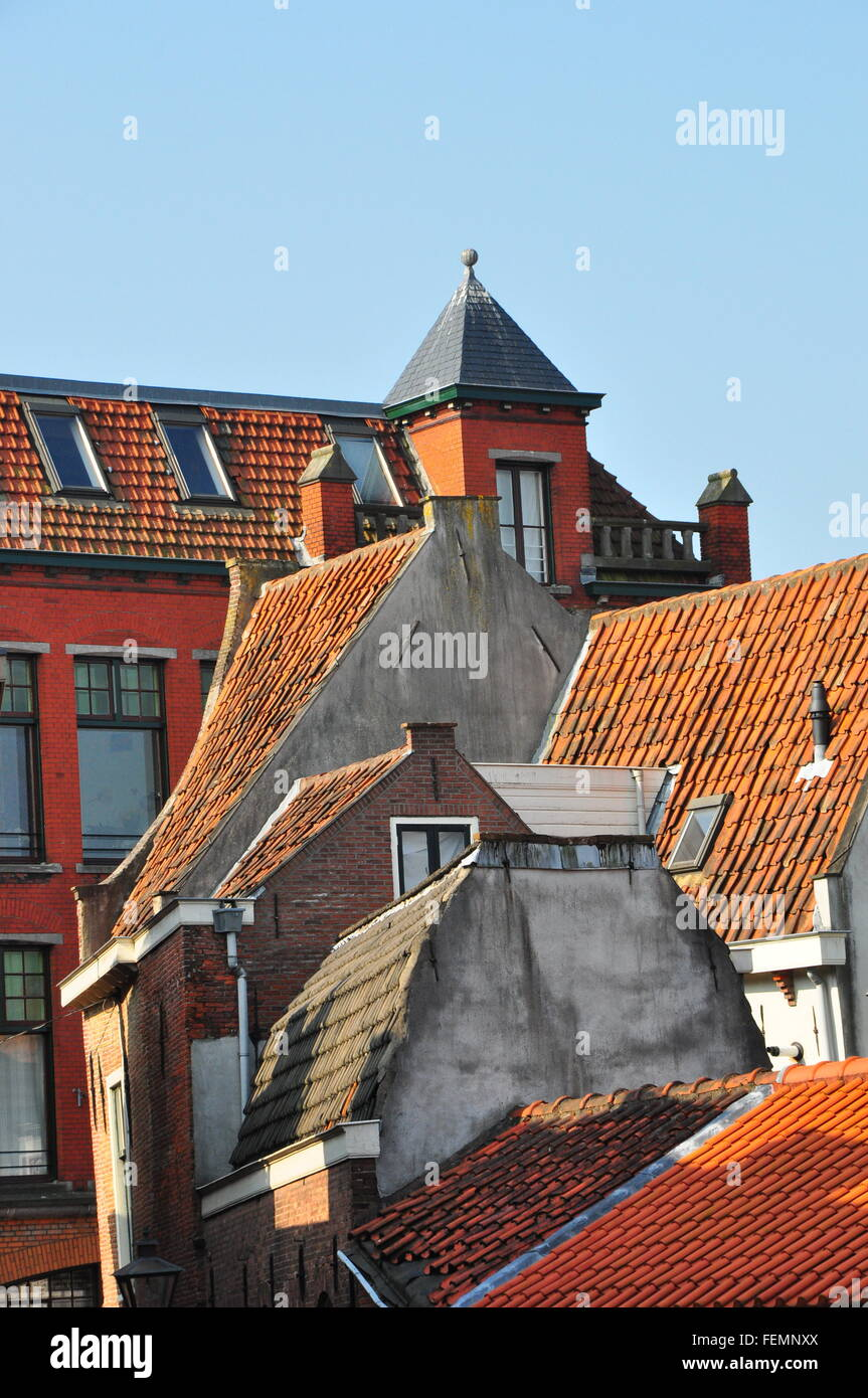 View Of Tiled Roofs Against Clear Sky - Stock Image
