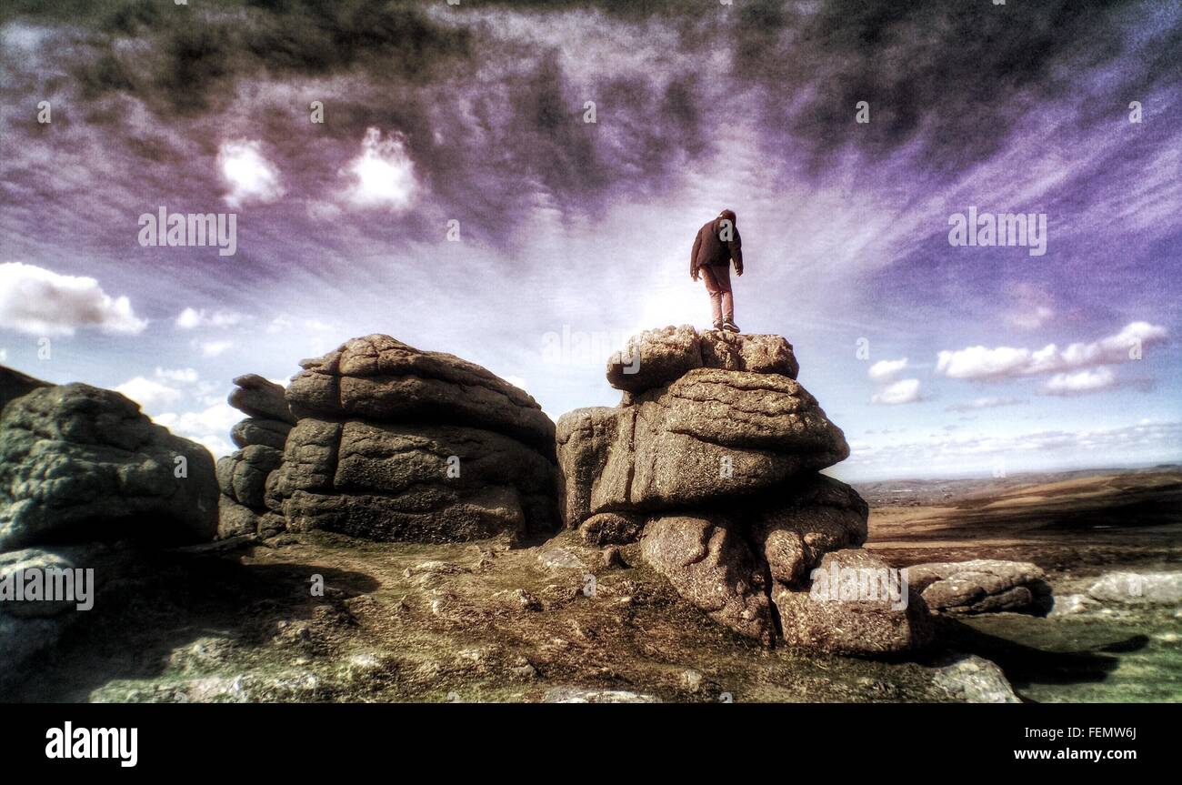 Low Angle View Of Person Standing On Rocks - Stock Image