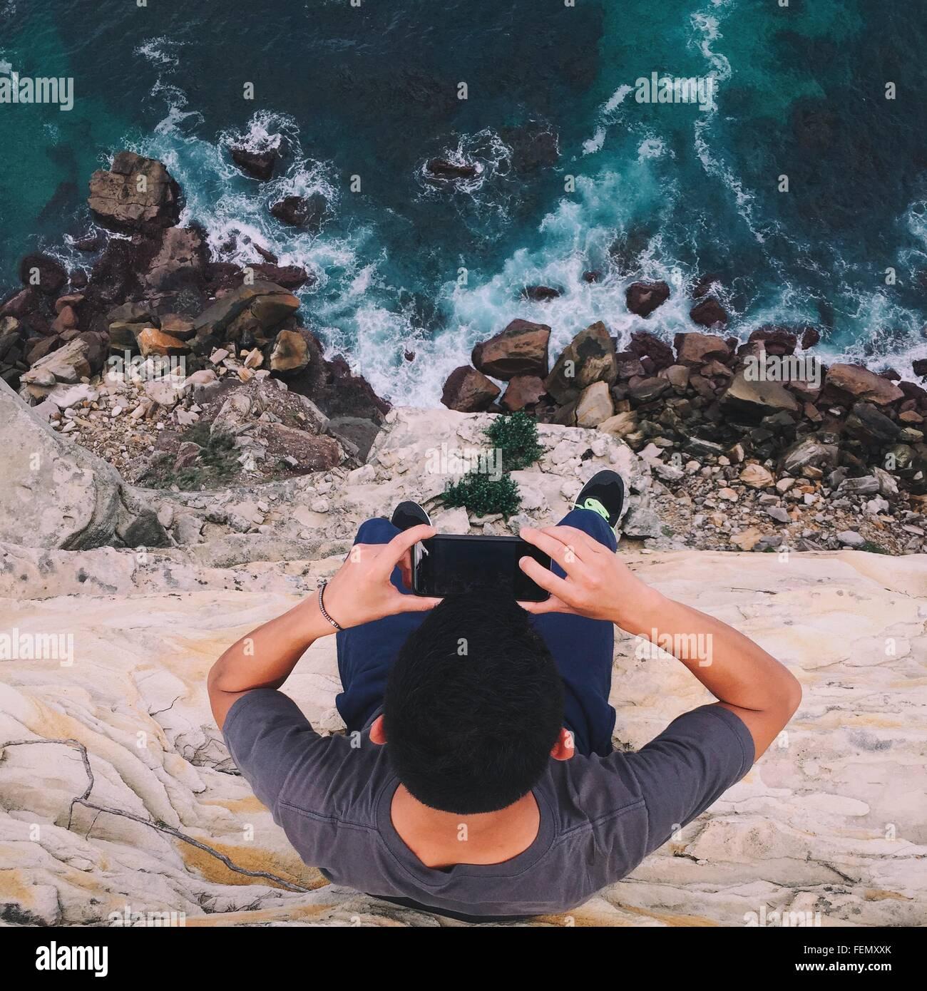 High Angle View Of Man Photographing Sea - Stock Image