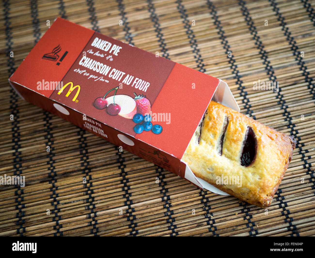 A McDonald's baked blueberry maple pie, a limited time menu item in McDonald's throughout Canada. - Stock Image