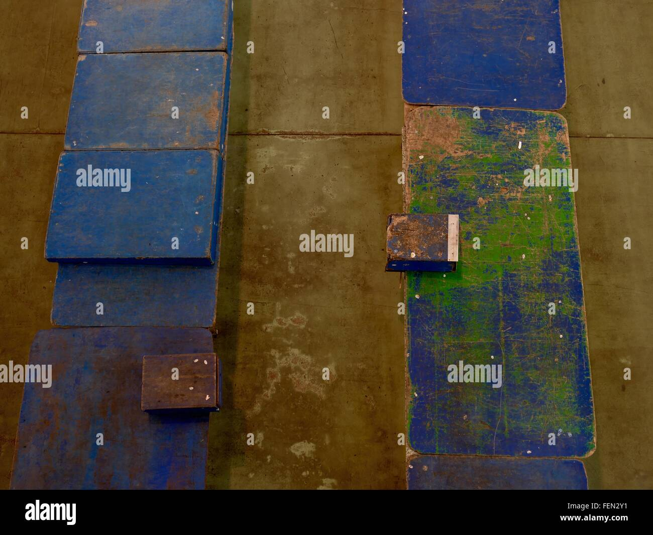 Old Blue And Green Planks On Concrete - Stock Image