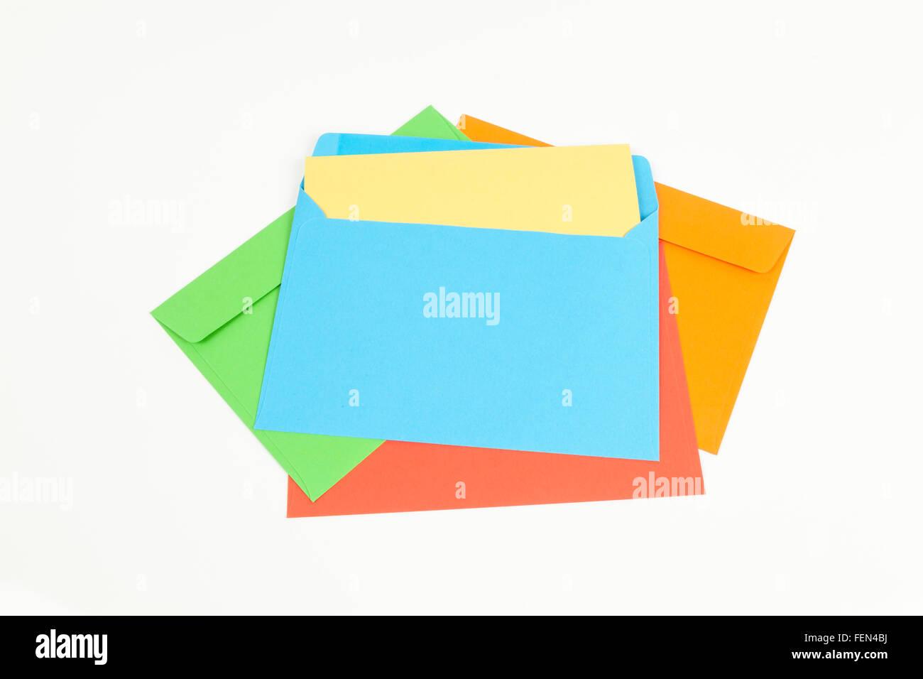 Colored envelopes on white - Stock Image