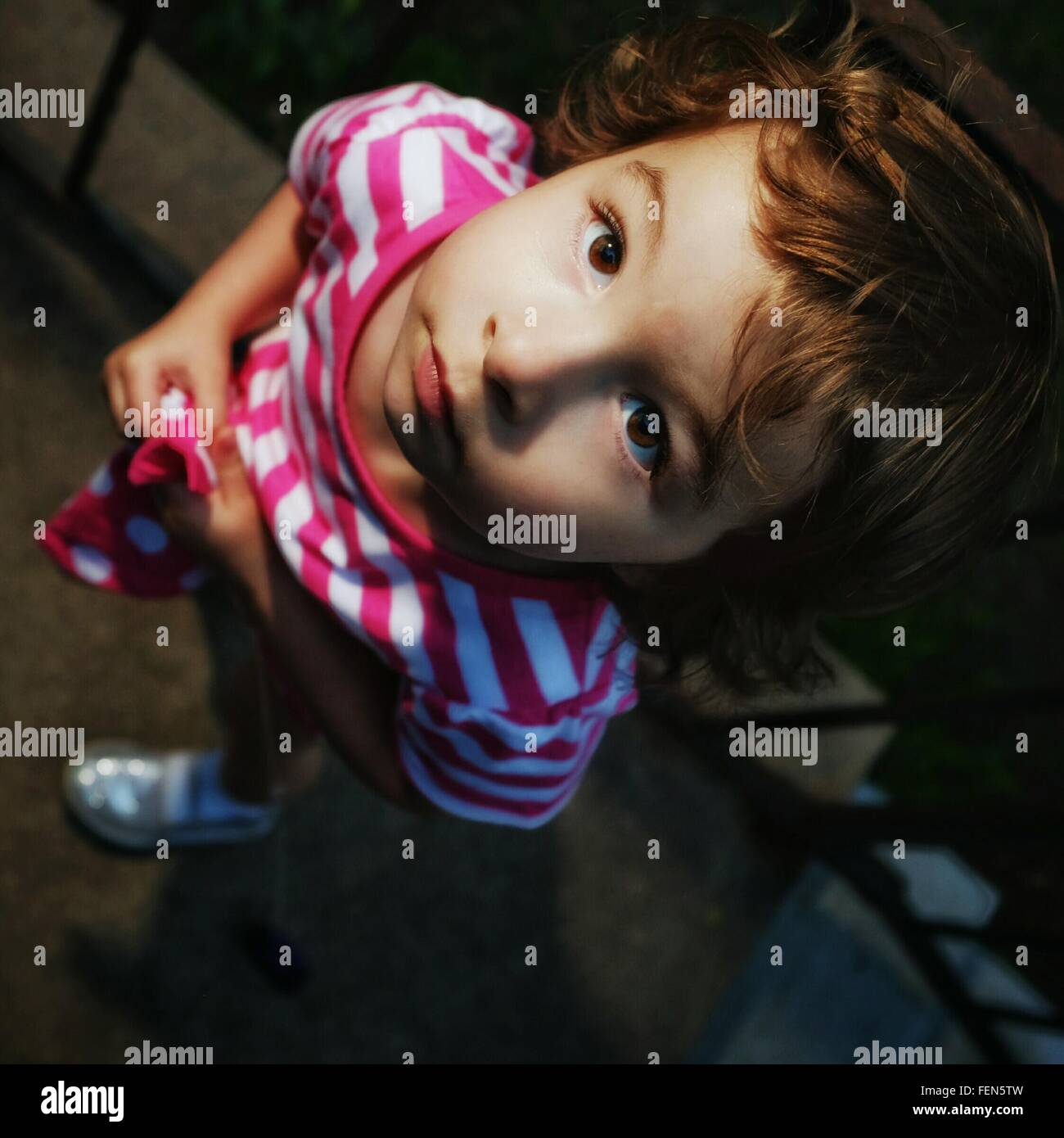 Directly Above View Of Girl Looking Up - Stock Image