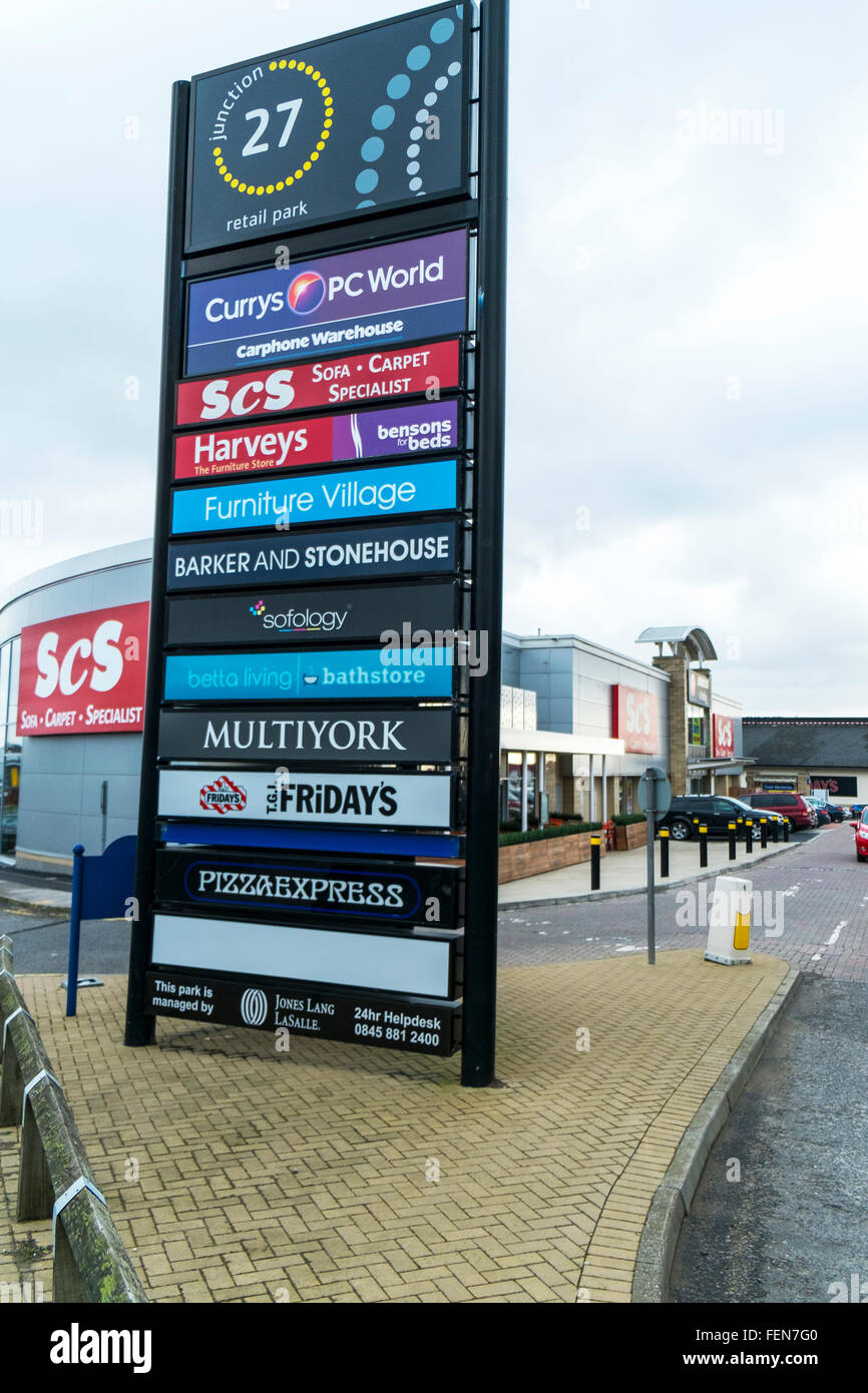 Birstall retail park Batley Leeds UK stores shops shopping centre sign brand names center cars parked outside store - Stock Image