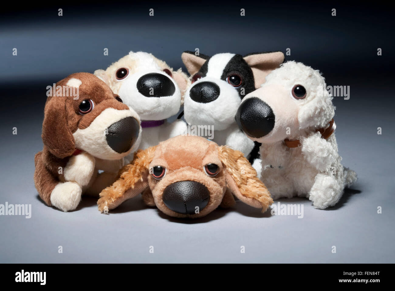 Mcdonalds happy meal soft toy dogs on grey background - Stock Image