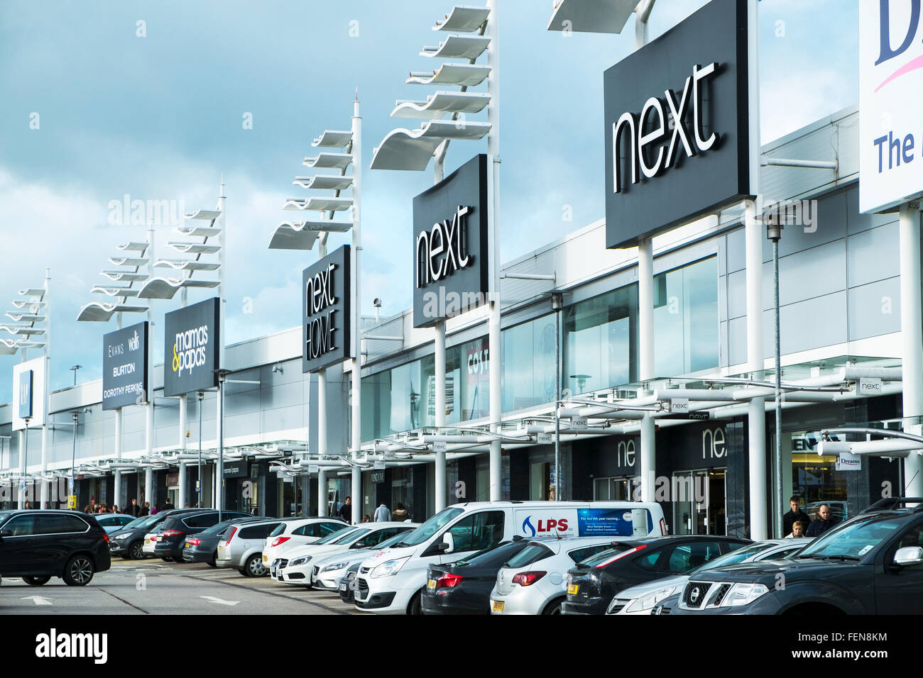 Birstall retail park Batley Leeds UK stores shops shopping centre center cars parked outside store shop - Stock Image